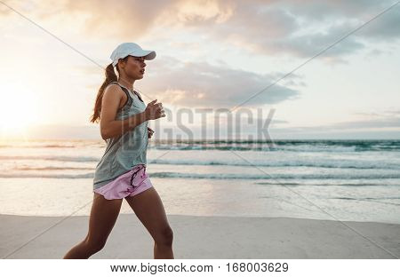 Beautiful Young Woman Jogging On Beach