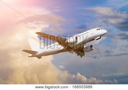 Airplane. Airplane with blank livery flying in the sky - travel background with flying airplane. Airplane closeup. Airplane in the flight. Travel concept with commercial airplane in the sky