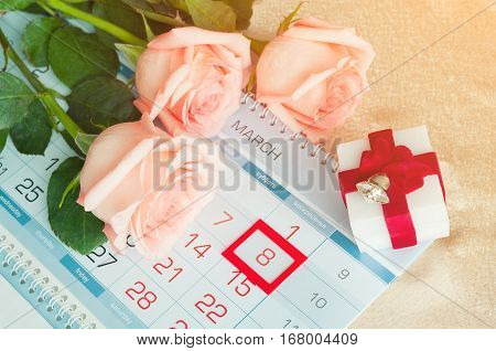 8 March card - peach roses over the calendar with framed 8 March date and box for jewel gift. 8 March is international women day