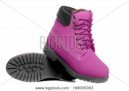 Pink boots. Angle view. Isolated on white background
