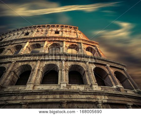 Rome, Italy.One of the most popular travel  place in world - Roman Coliseum under evening sun light and sunrise sky with long exposure.