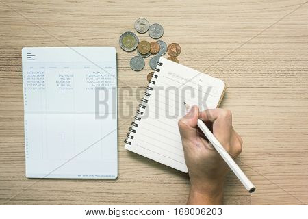 Hand Write On Note Book With Text Interest With Account Bank Book And Coins