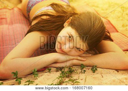 Teen Girl Lay On The Beach Close Up Photo