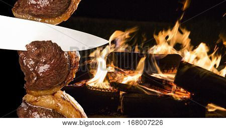 Picanha traditional Brazilian barbecue. Background with fire