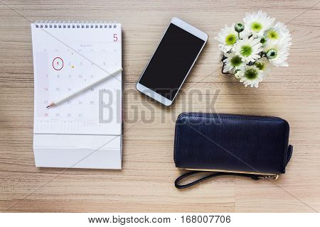 Calendar Marked At 1St Of Month With Wallet And Smart Phone Or Mobile