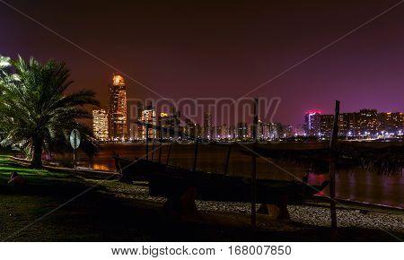 Night Panorama of Abu Dhabi at sunset time capital of United Arab Emirates. Abu Dhabi skyline - United Arab Emirates