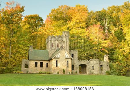 Squire's Castle in Cleveland Metroparks with Autumn trees background