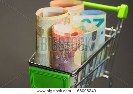 Euro banknotes standing in the shopping cart preapred for taking. Easy access on loan. Macro photo of european currency.