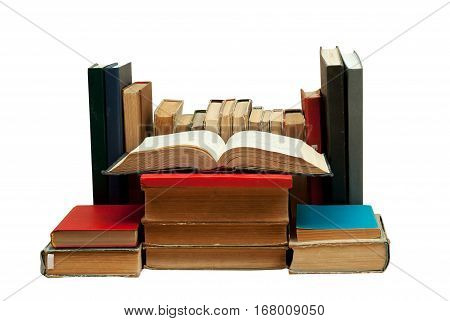 Open book stack of hardback books isolated. Back to school. Copy space