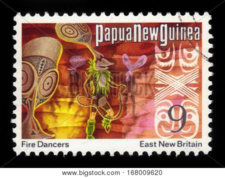 PAPUA NEW GUINEA - CIRCA 1973: stamp printed in Papua New Guinea shows a fire dancers from East New Britain, circa 1973
