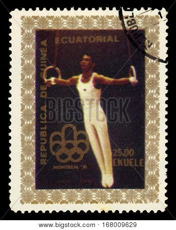 Equatorial Guinea - CIRCA 1976: stamp printed in Equatorial Guinea shows gymnastics, exercise on the rings, Summer Olympics 1976, Montreal, circa 1976
