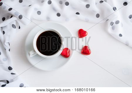 Love background - cup of coffee heart shaped candies with frame of chiffon polka dot scarf, love background. Love romantic background, romantic love morning concept