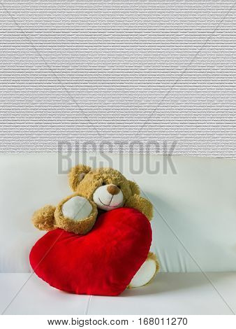 Cute Bear Dool With Big Red Heart On White Sofa And Empty Space Wall