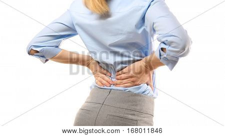 Young woman suffering from pain in back on white background