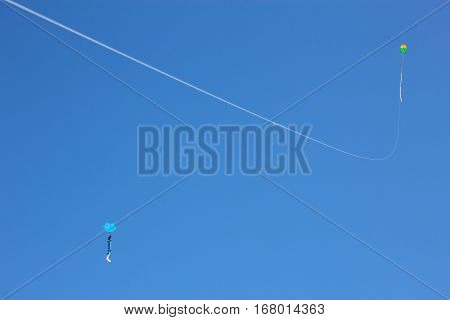 Two Kites Flying over a Blue Sky