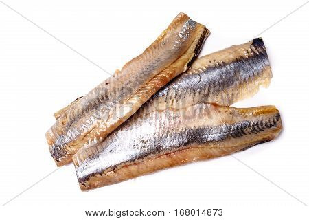 Fillet, Back Of The Herring Lies On A White Background. Not Isolated.