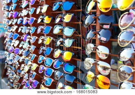 NESSEBAR, BULGARIA - AUG 28: Bright sunglasses in the window of a street shop on the waterfront of resort town in Nessebar, Bulgaria at August 28, 2016
