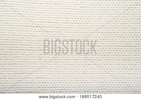 Pattern of the White Knitted Fabric Texture. Woolen background