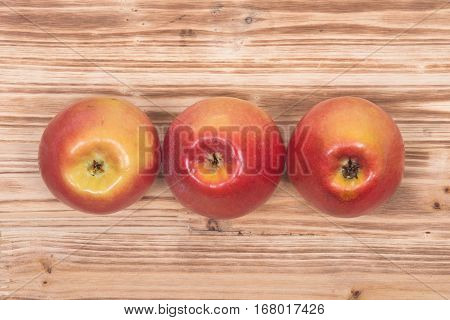 Ripe organic kanzi apple on vintage wooden tray