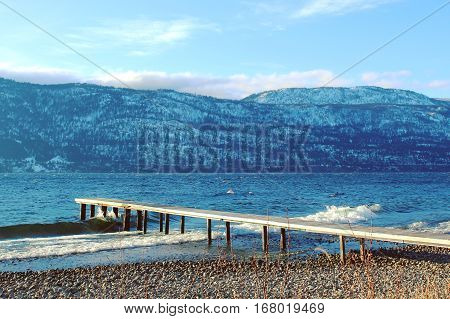 Wooden Pier On Lake In Winter Season