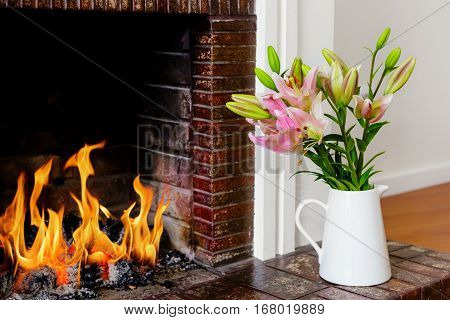 A Flower Vase Arrangement by the Fireplace