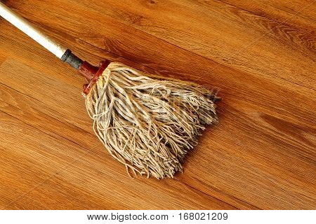 cleaning colorful wooden parquet with old mop