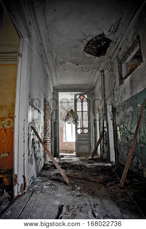 Old rotten doorway and corridor of an abandoned mansion of Khvostov  in gothic style, Lipetsk region