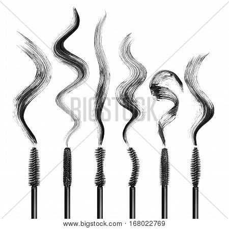 Set of various mascara brushes with mascara strokes isolated on white background