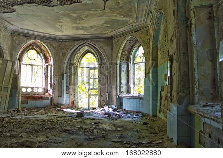 Old room with rotten window and doorway of an abandoned homestead of Khvostov in gothic style, Lipetsk region