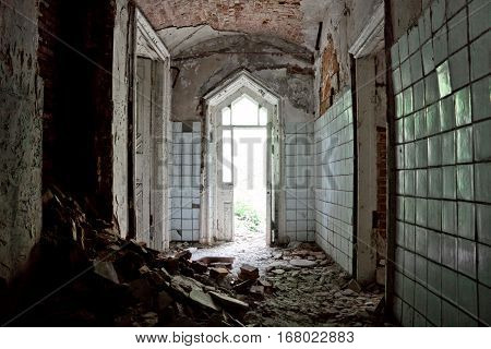 Corridor with doorway of an abandoned mansion of Khvostov in gothic style, Lipetsk region