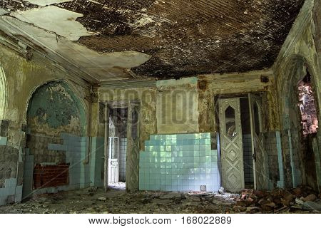 Old room with rotten doorway of an abandoned mansion of Khvostov in gothic style, Lipetsk region