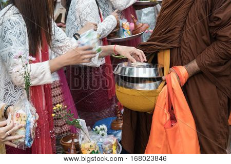 Kanchanaburi Thailand - January 12 2017:Traveler crowd make merit with monk in morning at Sangkhlaburi District Kanchanaburi Thailand