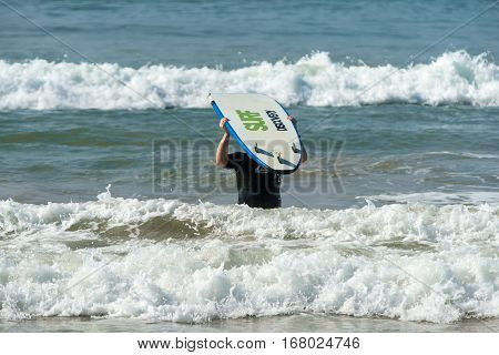 Weligama, Sri Lanka - January 09 2017: Unidentified Man Surfing On A Large Wave On Weligama Beach On