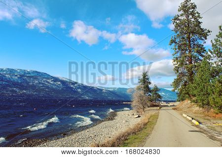Paved Road Along Scenic Lake
