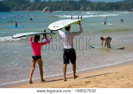 Weligama, Sri Lanka - January 09 2017: Unidentified Couple Surfing On A Large Wave On Weligama Beach