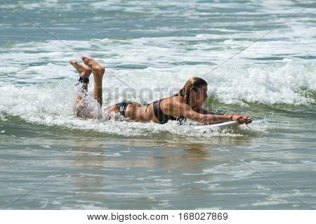 Weligama, Sri Lanka - January 09 2017: Unidentified Woman Surfing On A Large Wave On Weligama Beach