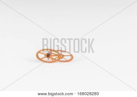 Two little watch gearwheel on white background