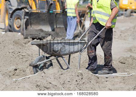 Construction Worker Pushing Wheelbarrow