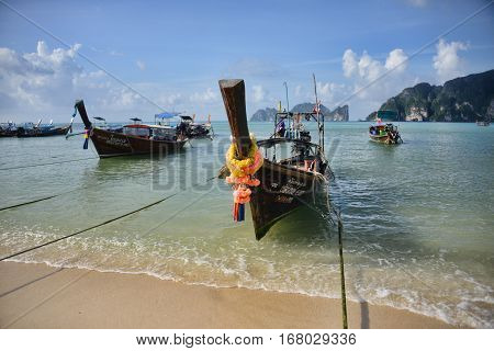 Traditional longtail boats in the famous Maya bay of Phi-phi Leh island Krabi province Thailand
