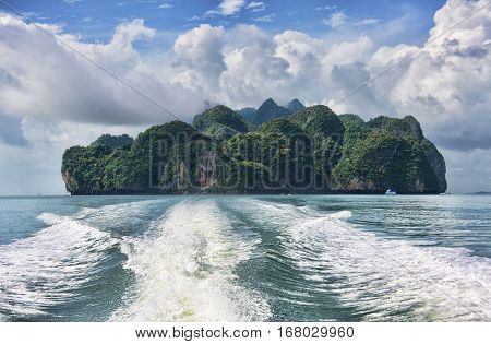 view of the tropical island and a trace of a speedboat