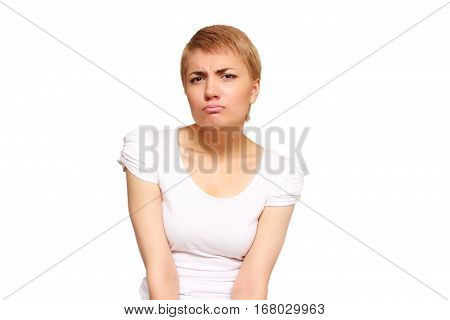 young woman is disappointed by the extent of her waist
