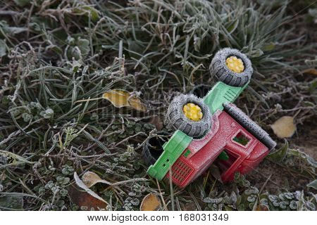Belarus, Minsk - October 13, 2016 / Autumn morning on the playground toy fell into the grass fallen leaves frost on the grass frost on a toy frozen ground.