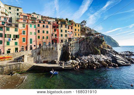 Small sea fishing port at bay of Riomaggiore town. Riomaggiore is a popular turistic town in Cinque Terre national park in Italy.