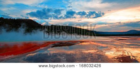 Grand Prismatic Spring Under Sunset Cloudscape In The Midway Geyser Basin In Yellowstone National Pa