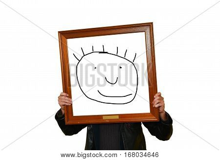 A man holds up an image frame with a comic face