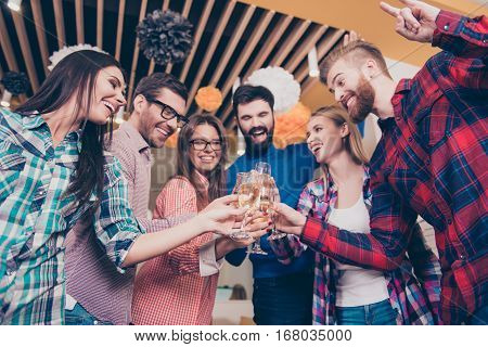 Portrait Of Beautiful Six Carefree Happy Friends  Clinking Glasses Of Wine With Toast In Campus. Fre