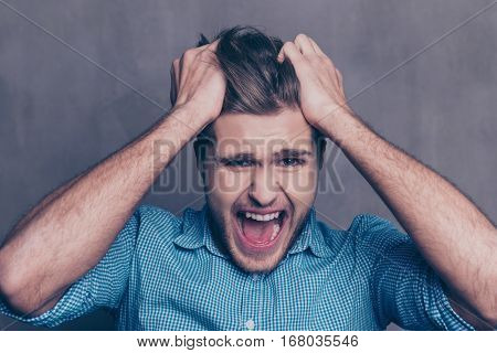Young Aggressive Tired Man Touching Head And Yelling