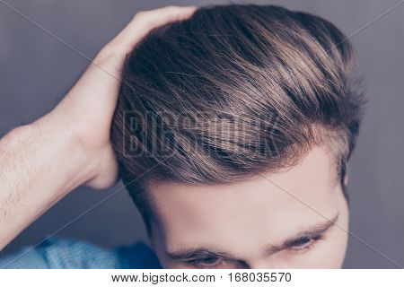 Close Up Photo Of Man Combing His Hair With Fingers
