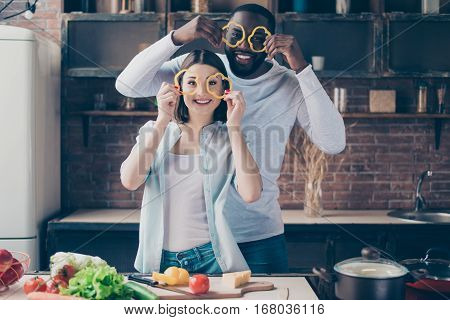 Two Cheerful Mixed Race People Together Cooking Healthy Breakfast. Handsome Afro American Guy  With