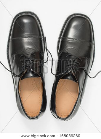 Pair of elegant mens shoes. Fashion black shiny leather. Isolated on a white background. Top view.
